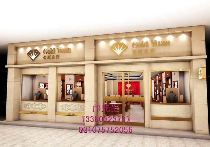 金源珠宝专卖店通过米黄色、金色与红色,结合表面材质的选择和细节的处理来彰显专卖店的整体风格。金源珠宝店的珠宝展示柜、背柜、精品柜与形象墙设计合理,搭配巧妙,浓浓的文化氛围展示了珠宝的独特魅力。 金源珠宝专卖店是由深圳展柜厂---艺菲达公司精心设计制作的,店面的布局,柜台设计及材质选择,风格的展示效果都是我公司全程把控。我公司是最专业的深圳展柜制作厂,致力于珠宝展示柜设计,珠宝展柜制作,化妆品展柜订做,化妆品展柜,服装展示柜,烟酒展示柜制作,珠宝店面设计及各类专卖店设计等。展柜制作的材质、尺寸、造型、颜色都